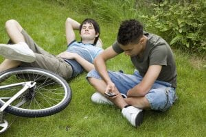 students relaxing in grass